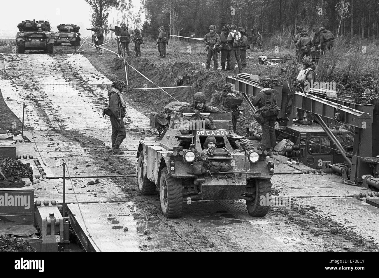 NATO exercises in Germany, British Army armored vehicles cross a pontoon bridge (September 1984) - Stock Image