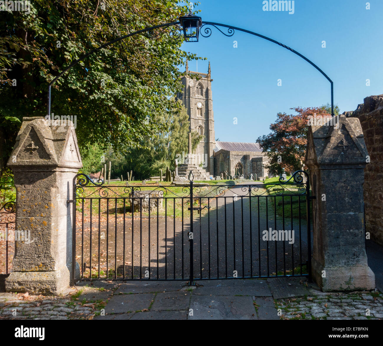 Iron arched entrance gates to St Andrew's church in the village of Chew Magna Somerset UK - Stock Image