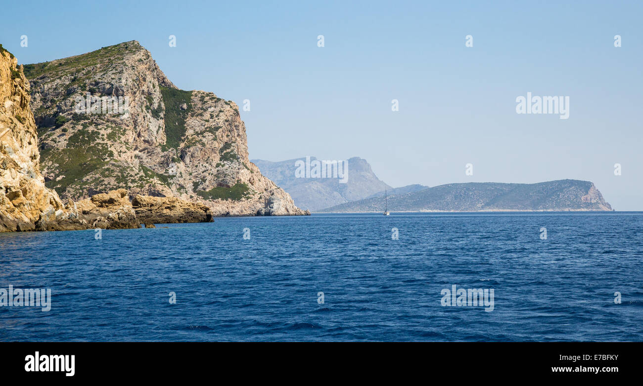 Coast of Alonissos in the Aegean Sea with the island of Panaghia in the distance - Stock Image