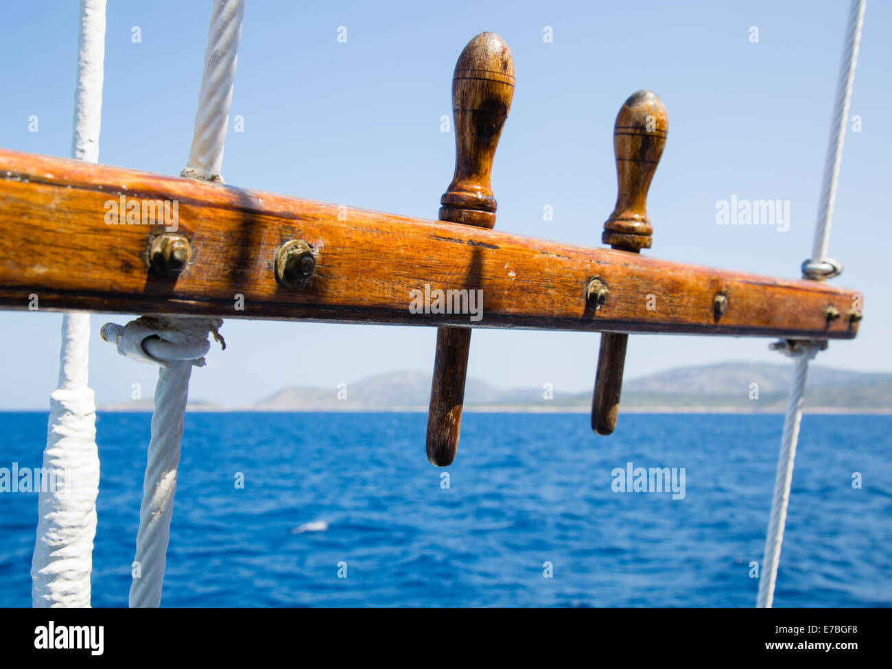 Section of the rigging of an antique sailing vessel plying between islands of the Sporades in the Greek Aegean Sea - Stock Image