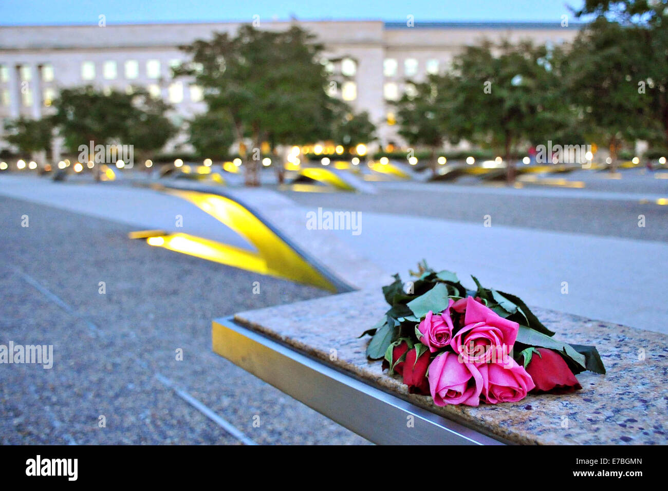 Lights illuminate the National 9/11 Pentagon Memorial as the sun sets on the eve of the anniversary of the 9/11 - Stock Image