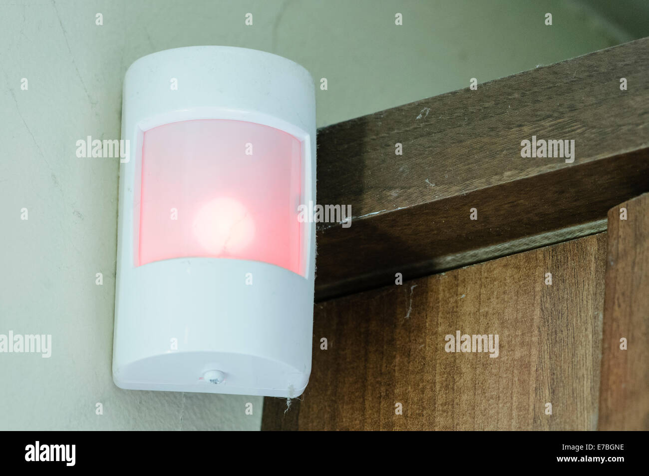 A passive Infra Red (PIR) detector as part of a household alarm system - Stock Image