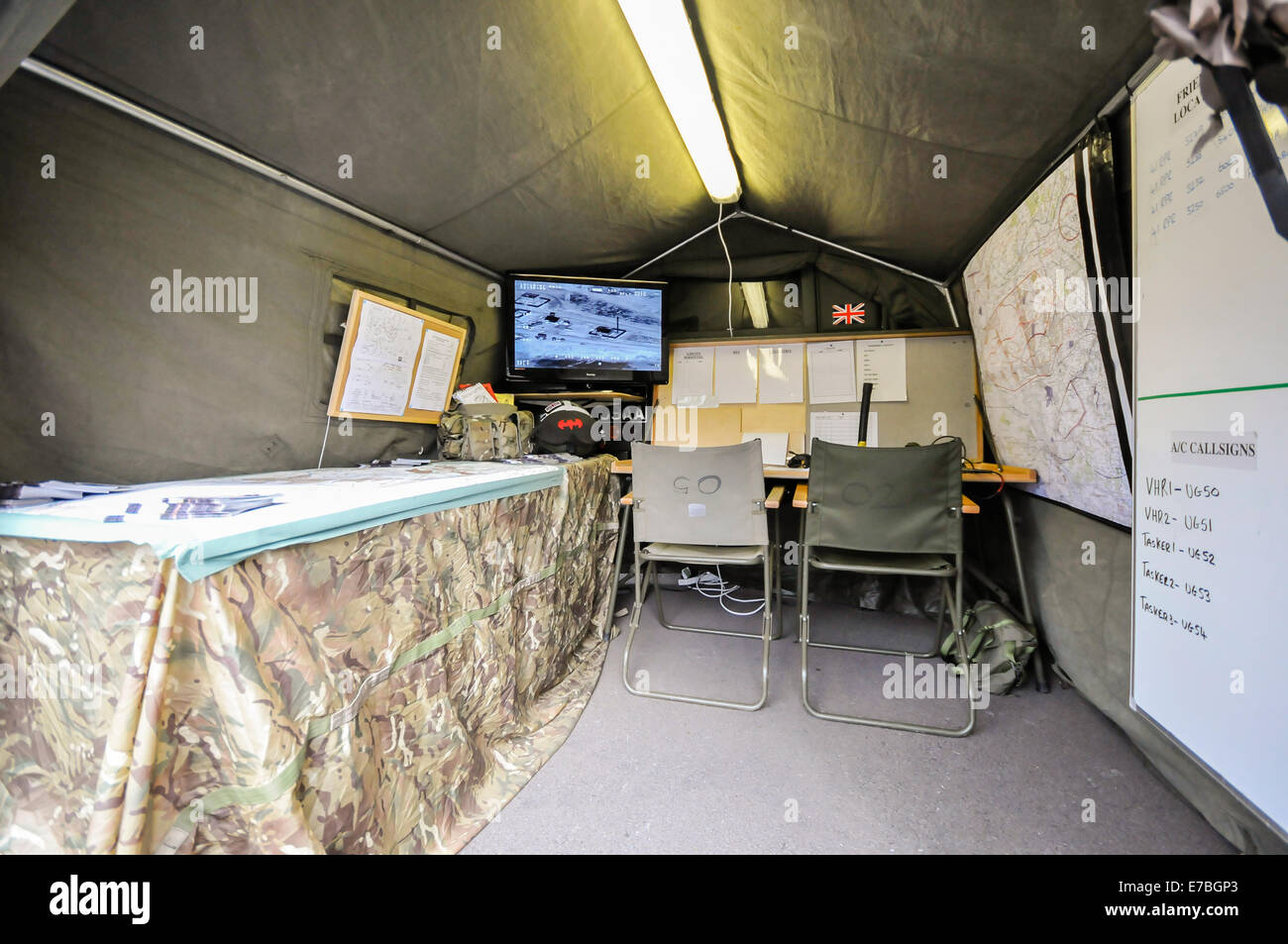 Mobile military command centre, set up on a camouflaged tent. - Stock Image