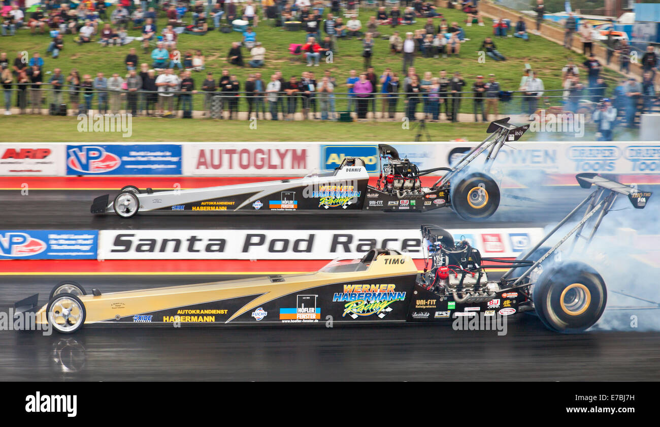 Top Methanol dragsters Santa Pod. Timo Habermann nearside Dennis Habermann far side. - Stock Image