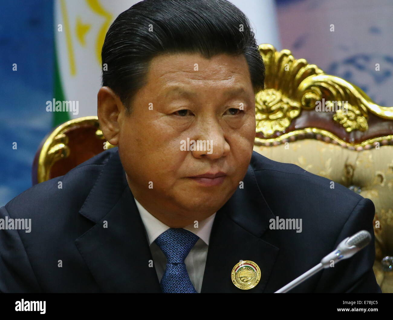 Dushanbe, Tajikistan. 12th Sep, 2014. President Xi Jinping of China looks on at a ceremony of signing joint documents - Stock Image