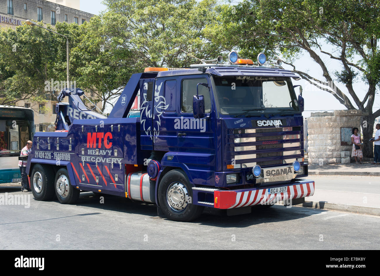 A Scania 144 Recovery Truck Is Being Prepared To Tow A