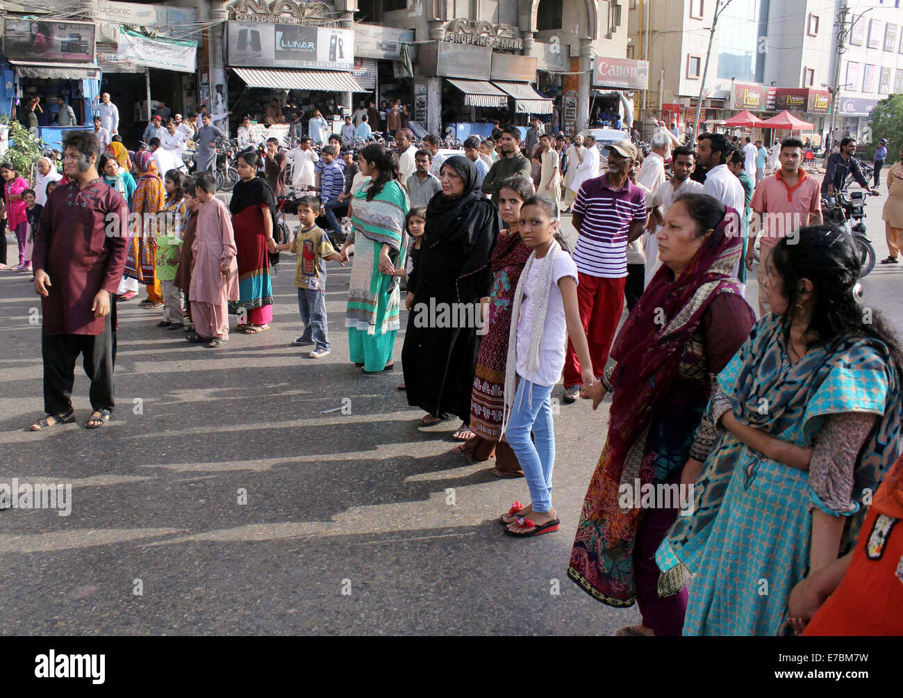 Residents of Naz Plaza are protesting against disconnection of electricity by K-Electric administration, at M.A - Stock Image