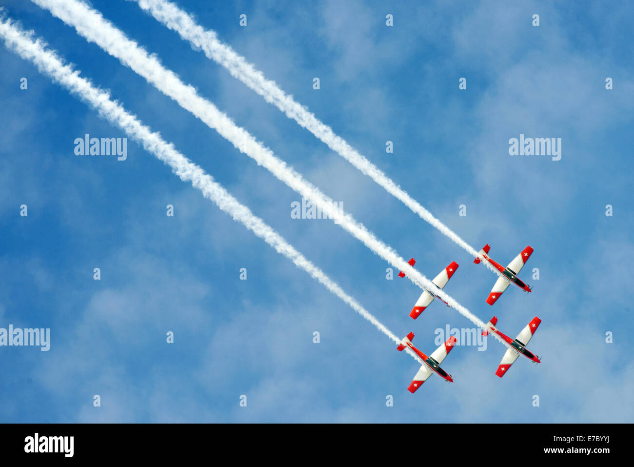 PAYERNE, SWITZERLAND - SEPTEMBER 7: Flight of PC-7 aerobatic team in close formation on AIR14 airshow in Payerne Stock Photo