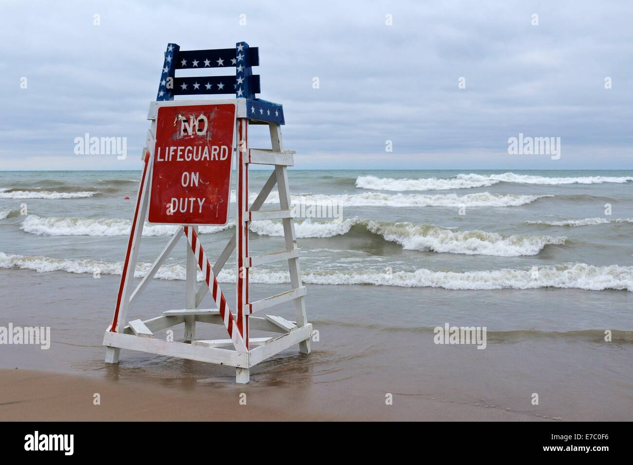 6e5e6d113e8 Empty lifeguard tower with No Lifeguard on Duty sign on deserted beach at  swimming season s end