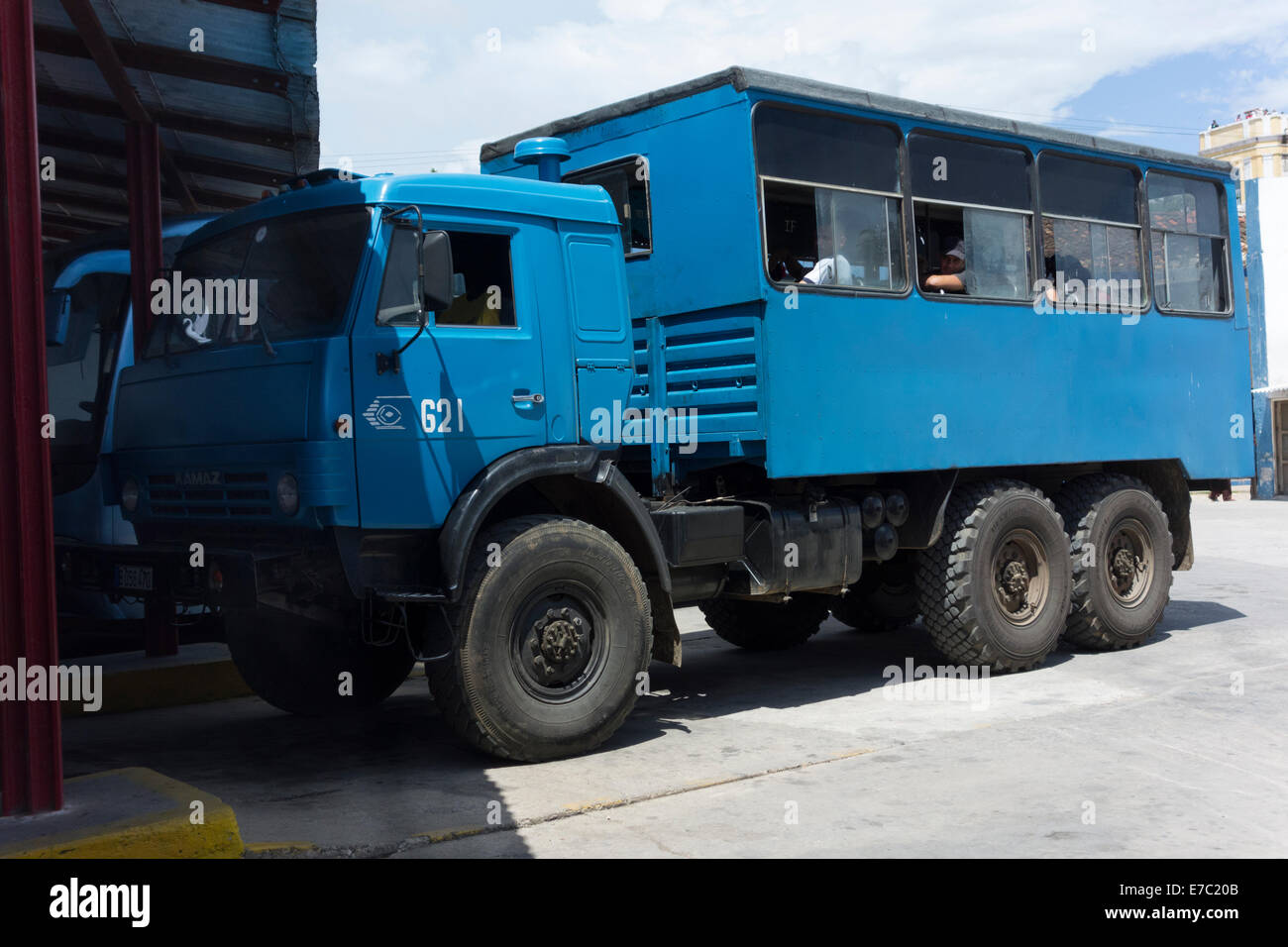 army lorry converted for public transportation, bus station, Cuba - Stock Image
