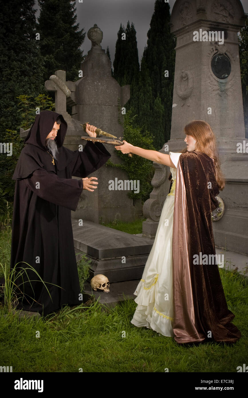 victorian lady holding a pistol towards an evil monk at halloween