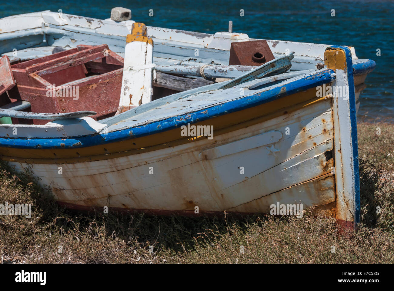 An abandoned and dilapidated old wooden boat