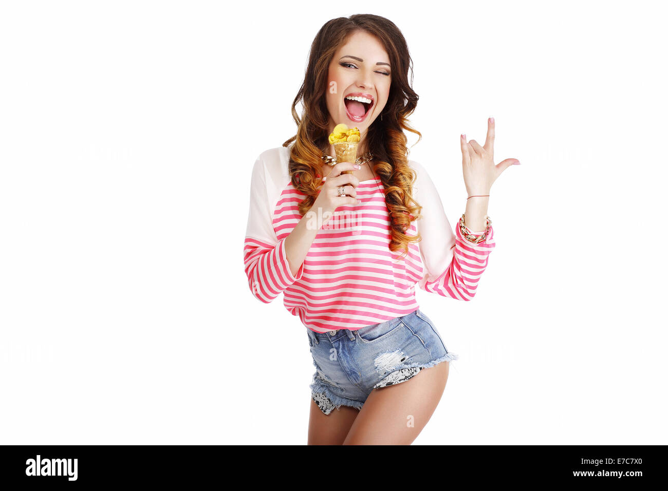 Sweetness. Cute Girl with Delicious Ice Cream Smiling - Stock Image