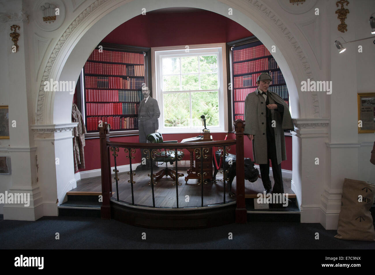 Writer Sir Arthur Conan Doyle and his fictional detective Sherlock Holmes display in Dartmoor national park visitor - Stock Image