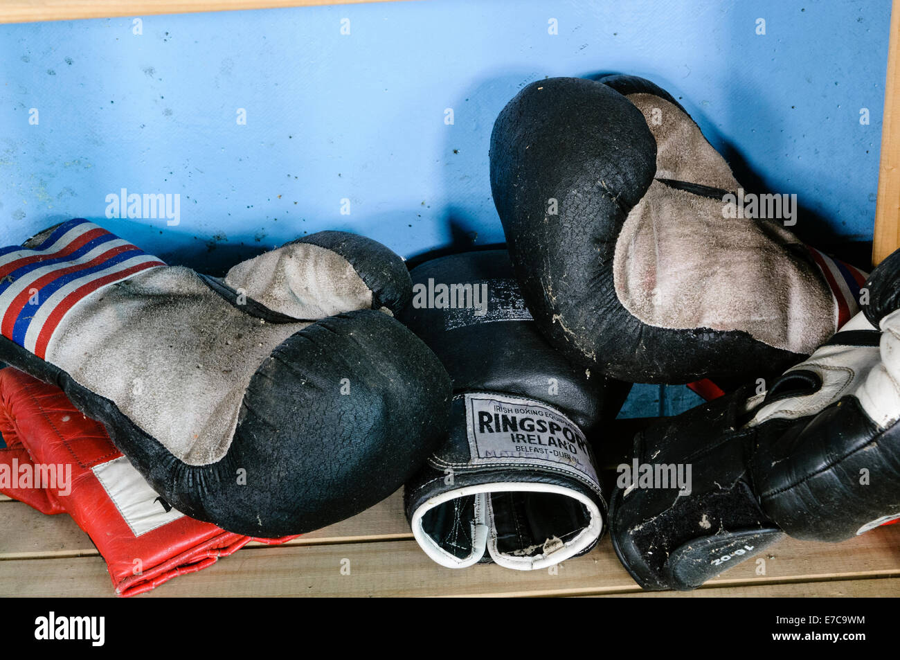 Old boxing gloves in a derelict boxing club - Stock Image