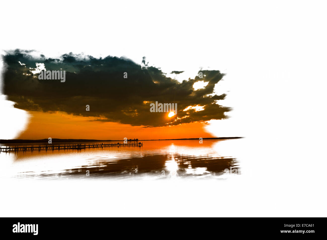 Graphics of Dramatic evening sky above the lake with a wooden pier in the foreground, Steinhude am Meer, Lower Saxony. - Stock Image