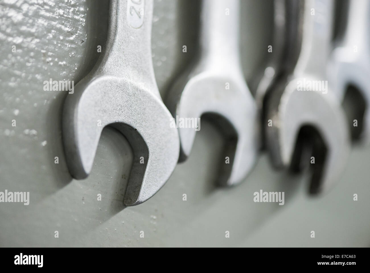 Spanners hanging on a tool rack - Stock Image