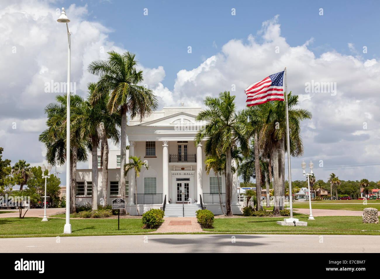 Freshly painted white and surrounded by palm trees, the classically designed City Hall in Everglades City, Florida, - Stock Image