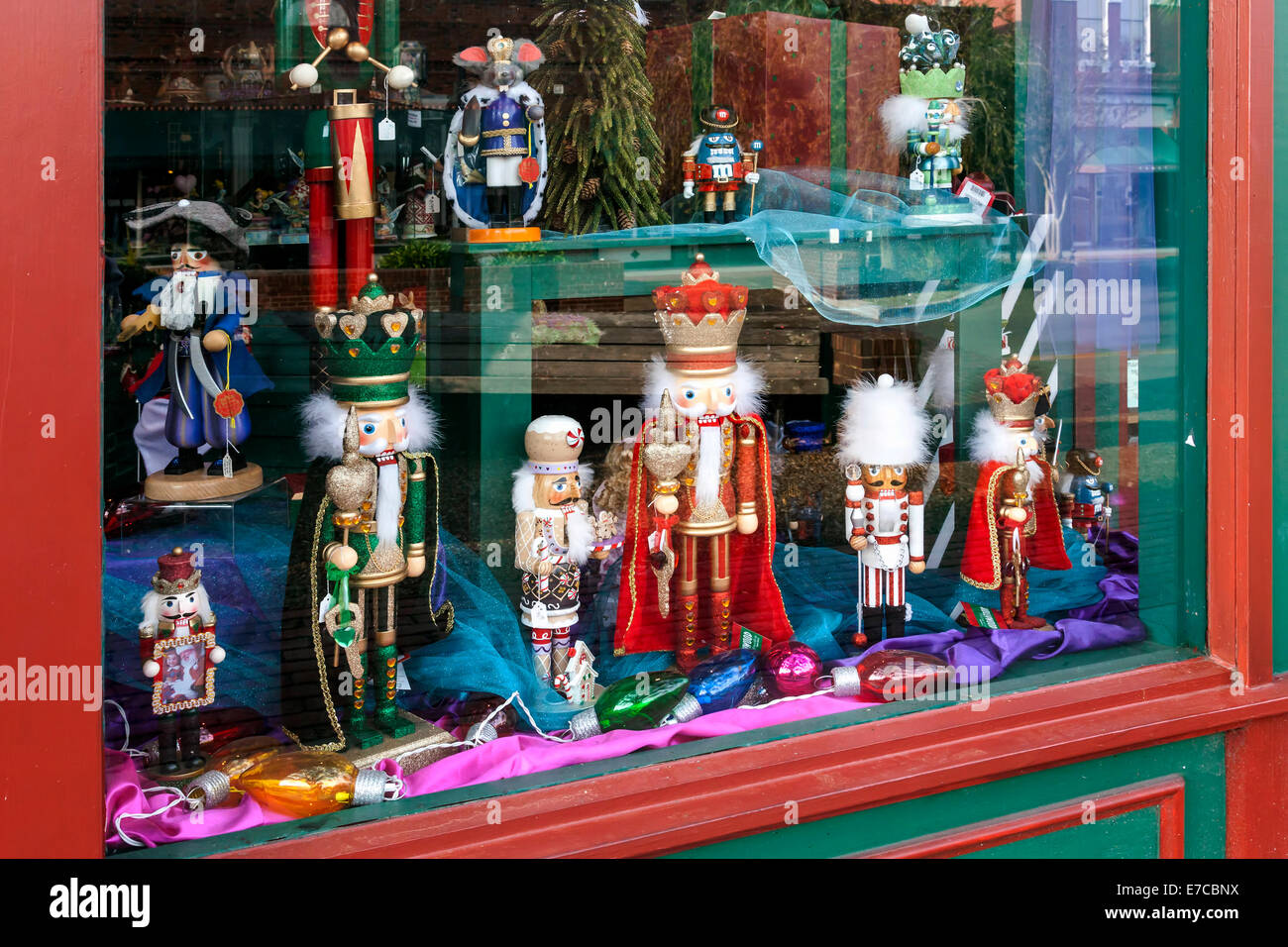santas nutcrackers and christmas decorations in old shop window in historic district of fernandina beach