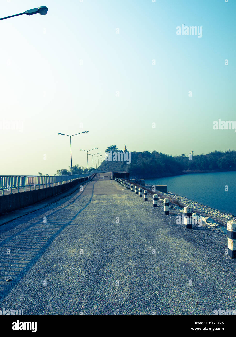 Cement road on lake in Chiang rai, Thailand: Filtered image:cross processed vintage effect. Stock Photo