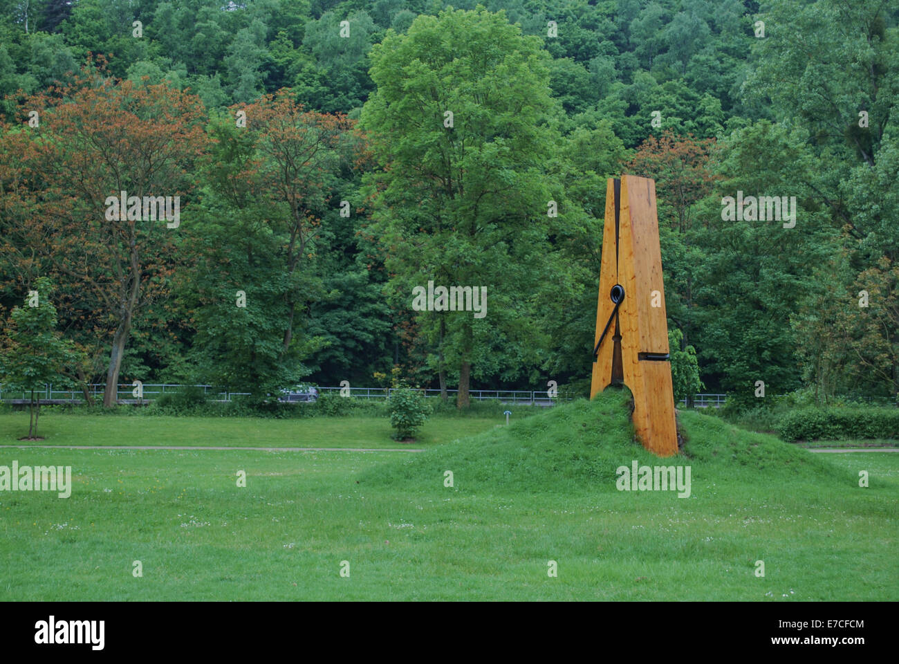 A giant clothespin sculpture creates a pinch in Liege, Belgium - Stock Image