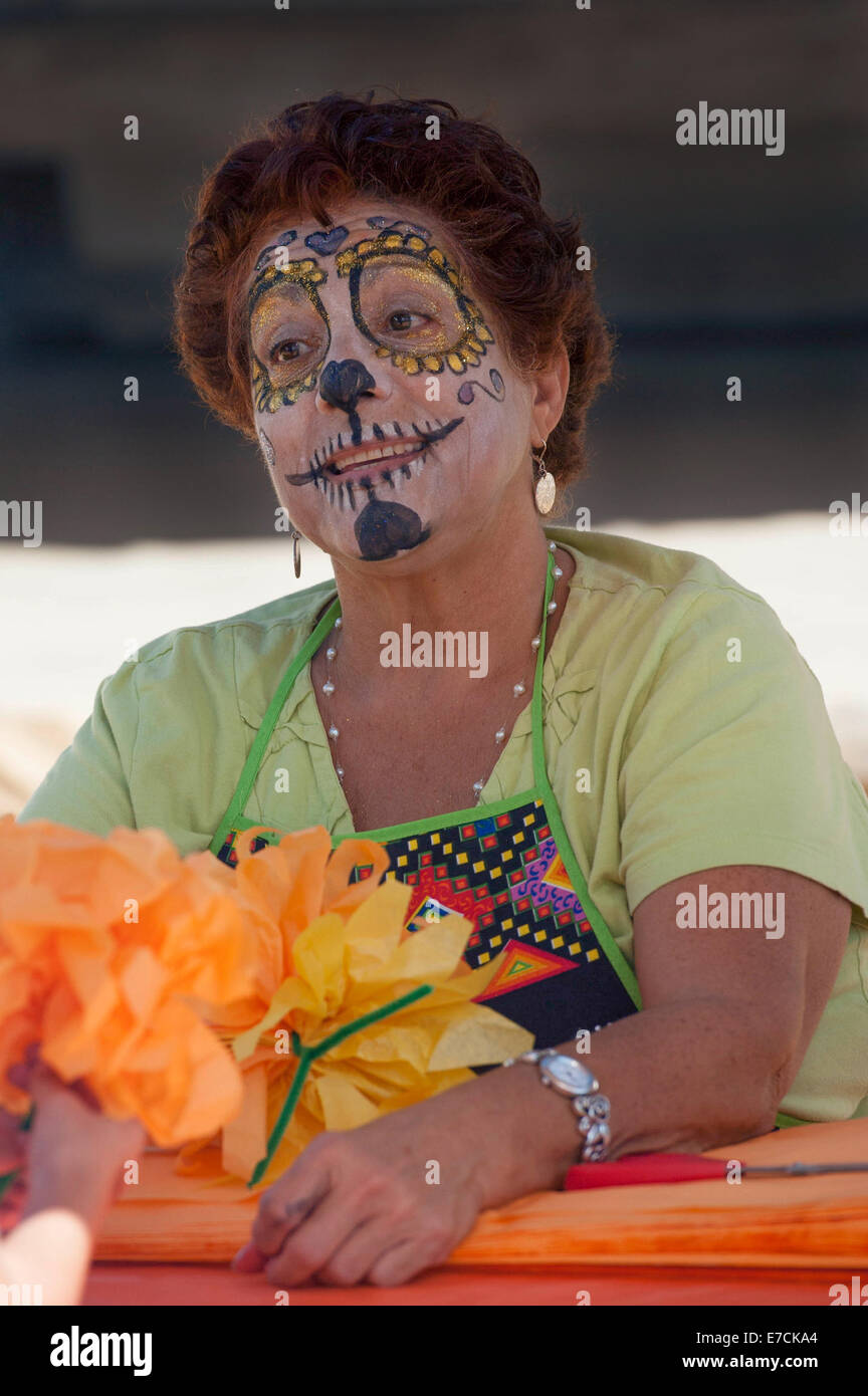 A woman with her face painted as a skull at the 2013 'Dia Del Muerto' happening at the 'Casa de la Guerra' - Stock Image