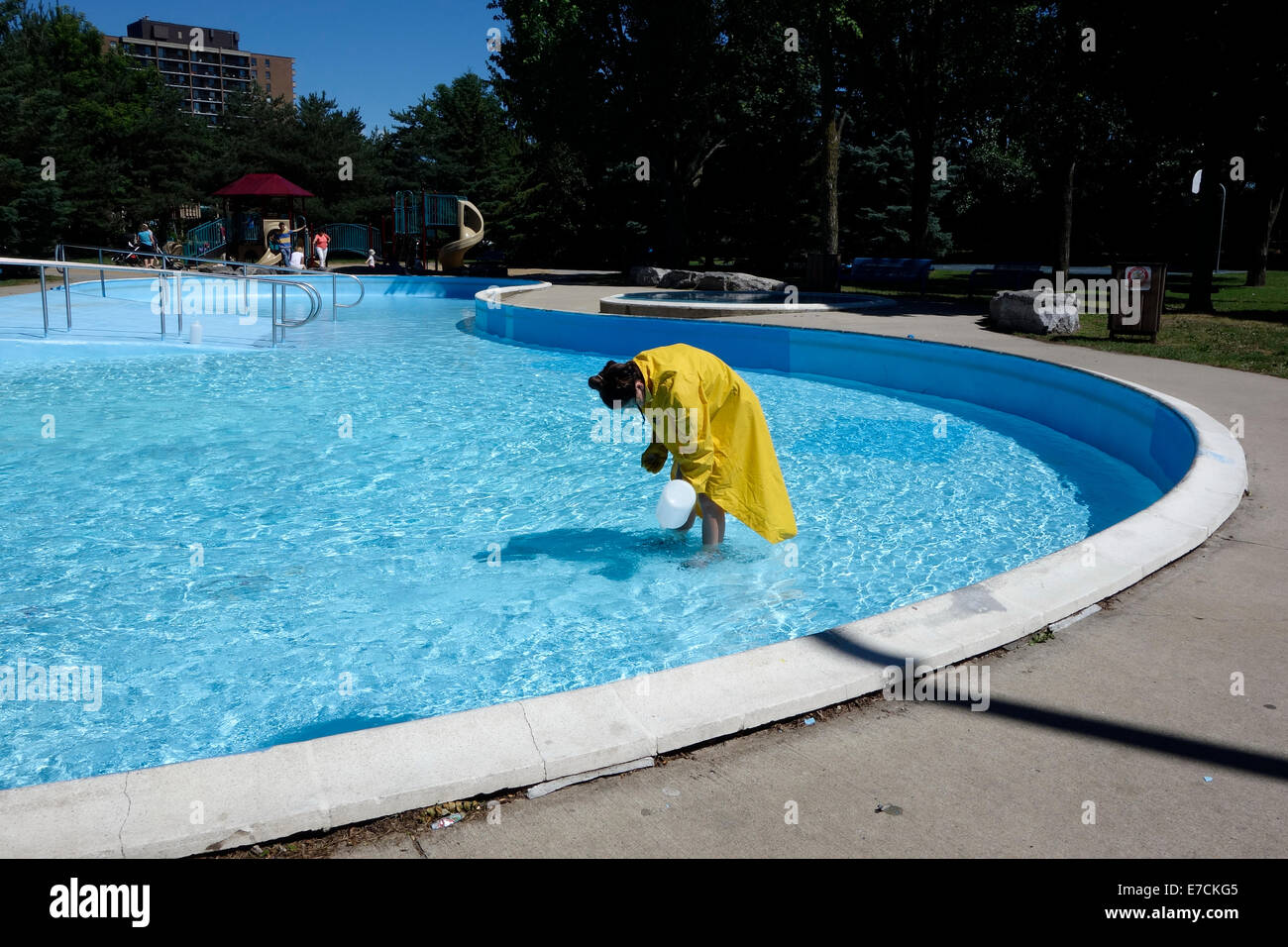 Come on kids and ply in my toxic pool - Stock Image