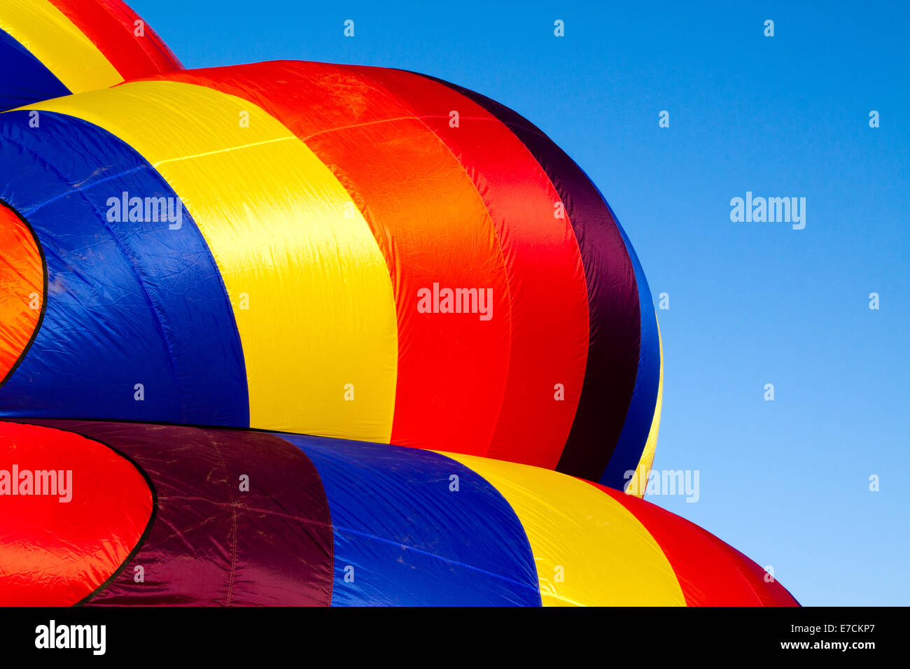 Detail of a hot-air balloon being inflated in early morning light Stock Photo