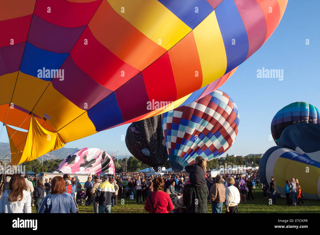 People watch as a colorful hot air balloons are inflated on the last day of the last scheduled Balloon Classic Stock Photo