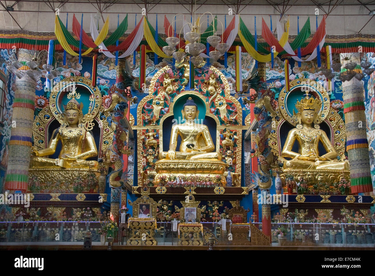 Lord Buddha at the centre, flanked by Lord Padmasambhava and Lord Amitayus on either side at Namdroling Monastery - Stock Image