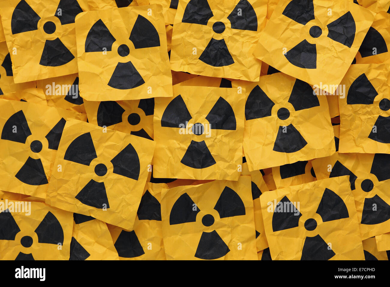 Crumpled adhesive notes with Radioactive Sign. Anti radiation concept. - Stock Image