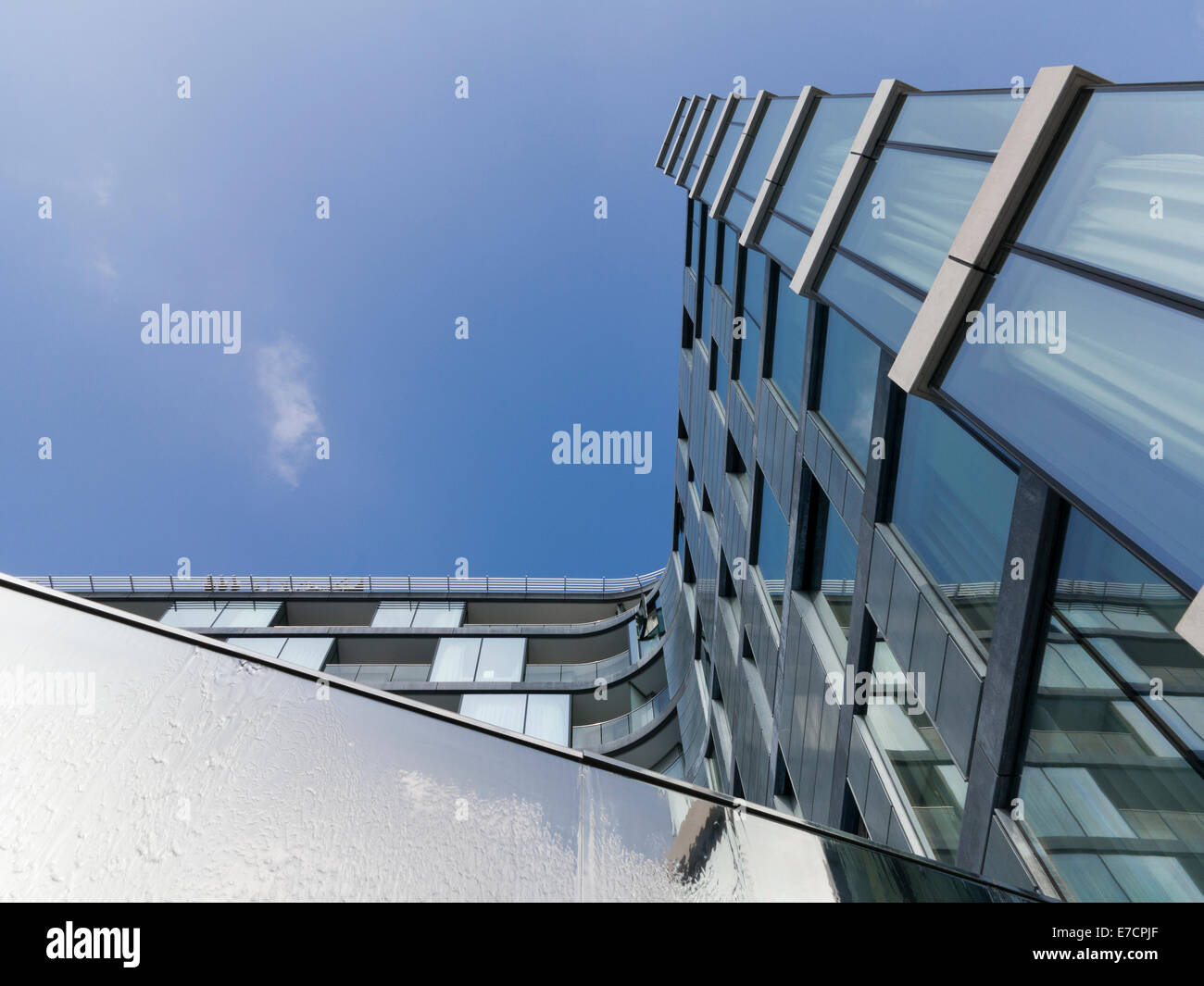 The Shard\'s distorted reflection in glass and steel framed windows ...
