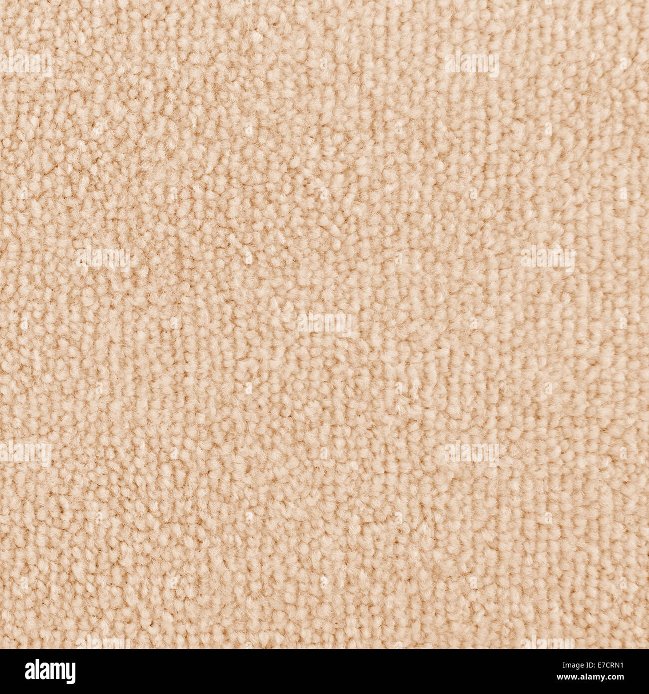 New carpet texture. Bright Beige carpet flooring as seamless background. - Stock Image