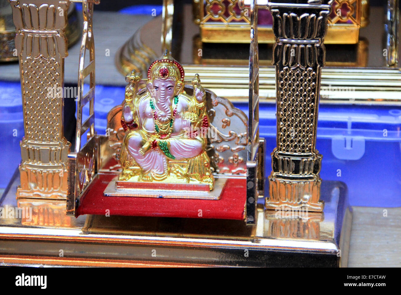 Ganesha on throne platform placed on swing with glittery frame - Stock Image