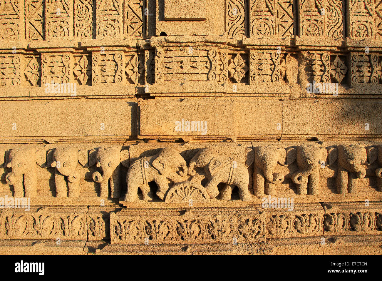 Etching of elephants in various postures on stone wall at Rukmini Temple, Dwaraka, Gujarath, India, Asia - Stock Image