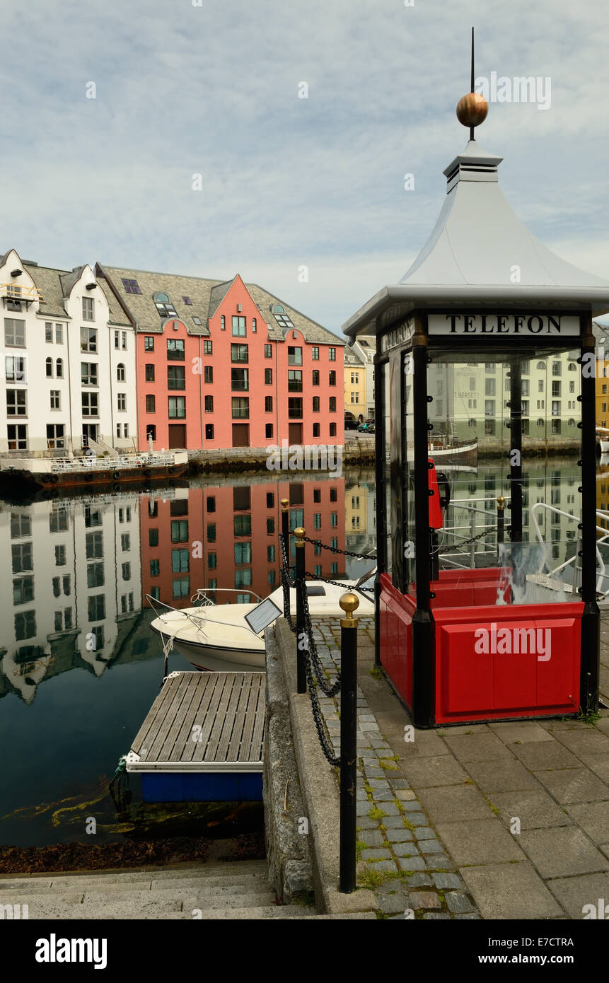 Telephone kiosk beside the inner harbour at Alesund, Norway. - Stock Image