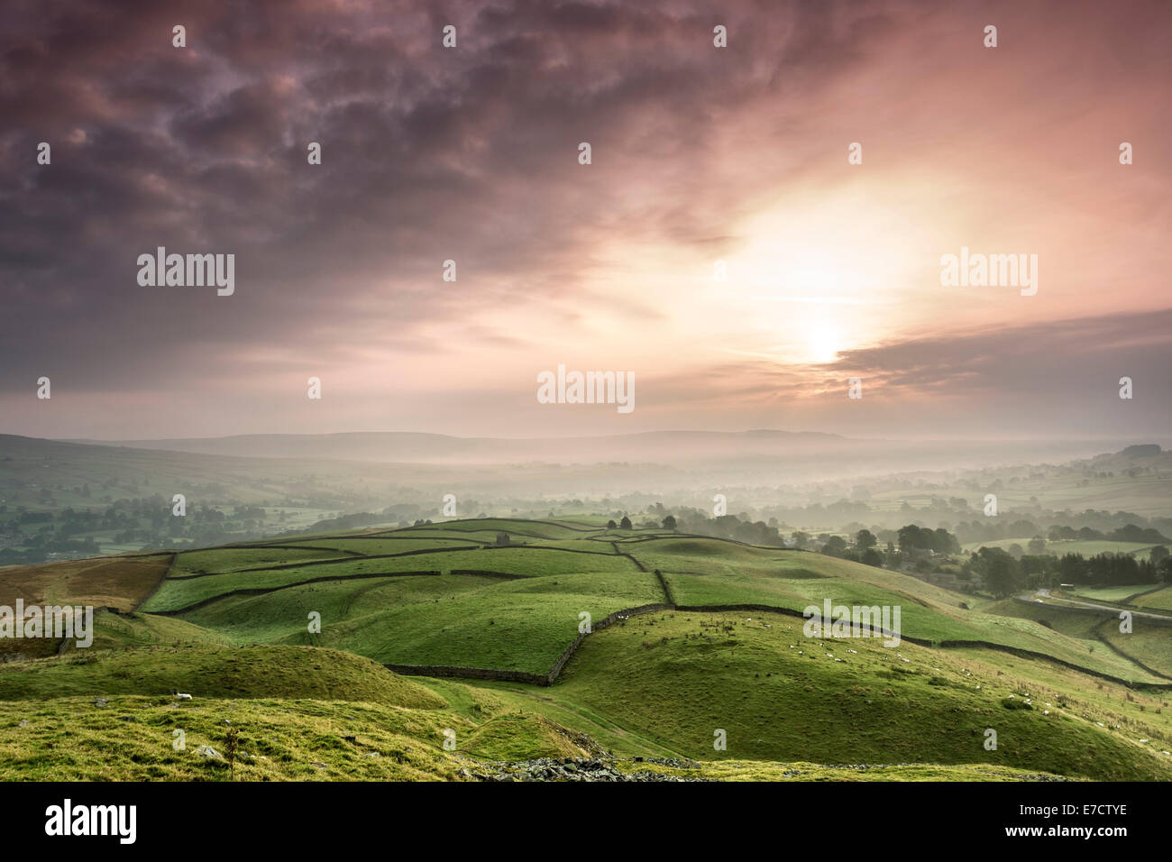 The View Across a Misty Teesdale at Sunrise From the Ancient Tumulus of Kirkcarrion, Lunedale, Teesdale, County, - Stock Image