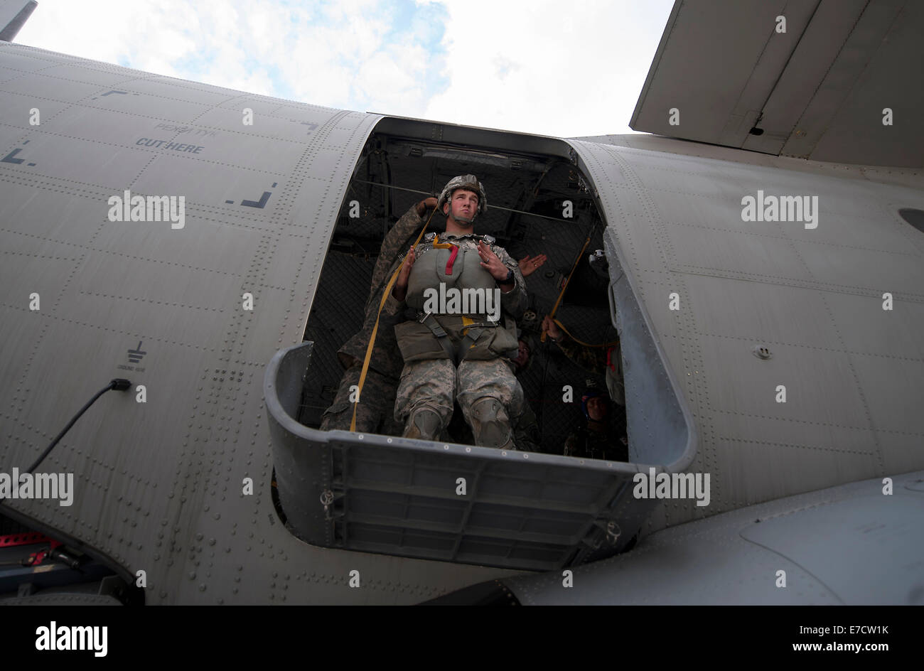 A US Army paratrooper with the 173rd Airborne Brigade Combat Team, practices jump procedures from a Bulgarian Air Stock Photo