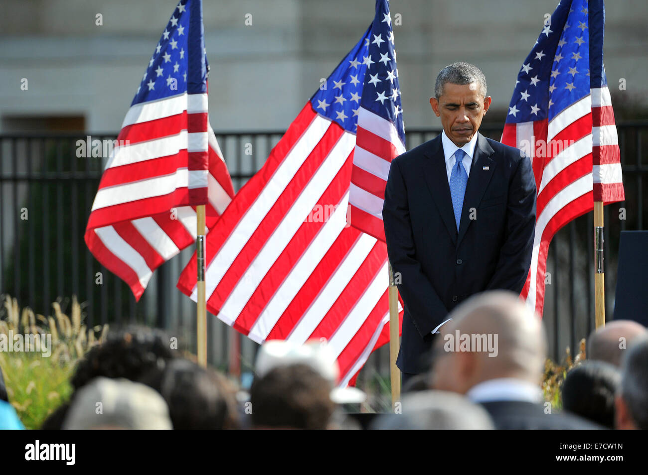 US President Barack Obama pauses for a moment of silence at the exact time of the attack on the Pentagon by terrorists - Stock Image