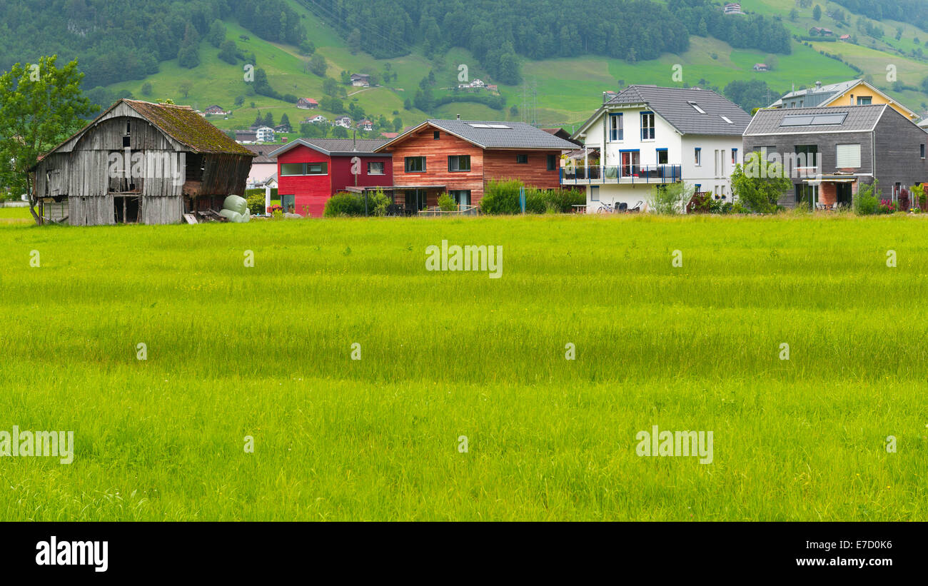 Various housing as a symbol of  difference of tastes, preferences, opportunities. A small village in central Switzerland - Stock Image