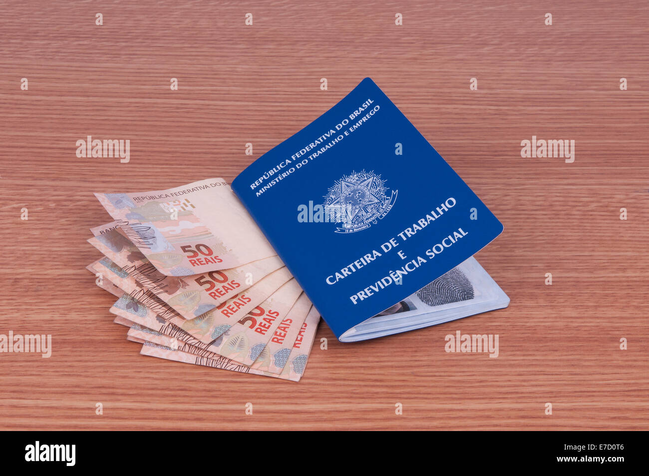Brazilian work document and social security document (carteira de trabalho) and brazilian currency (Real) - Stock Image
