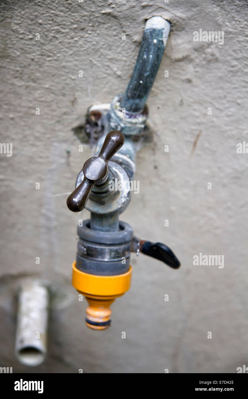 Exterior wall water tap with hose attachment - Stock Image