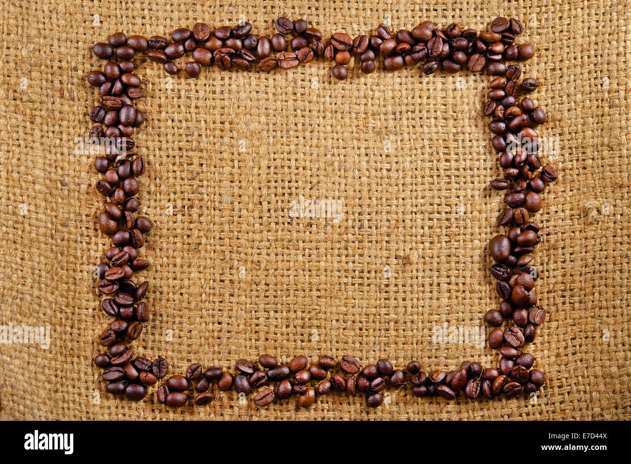 Coffee frame on burlap bag - Stock Image