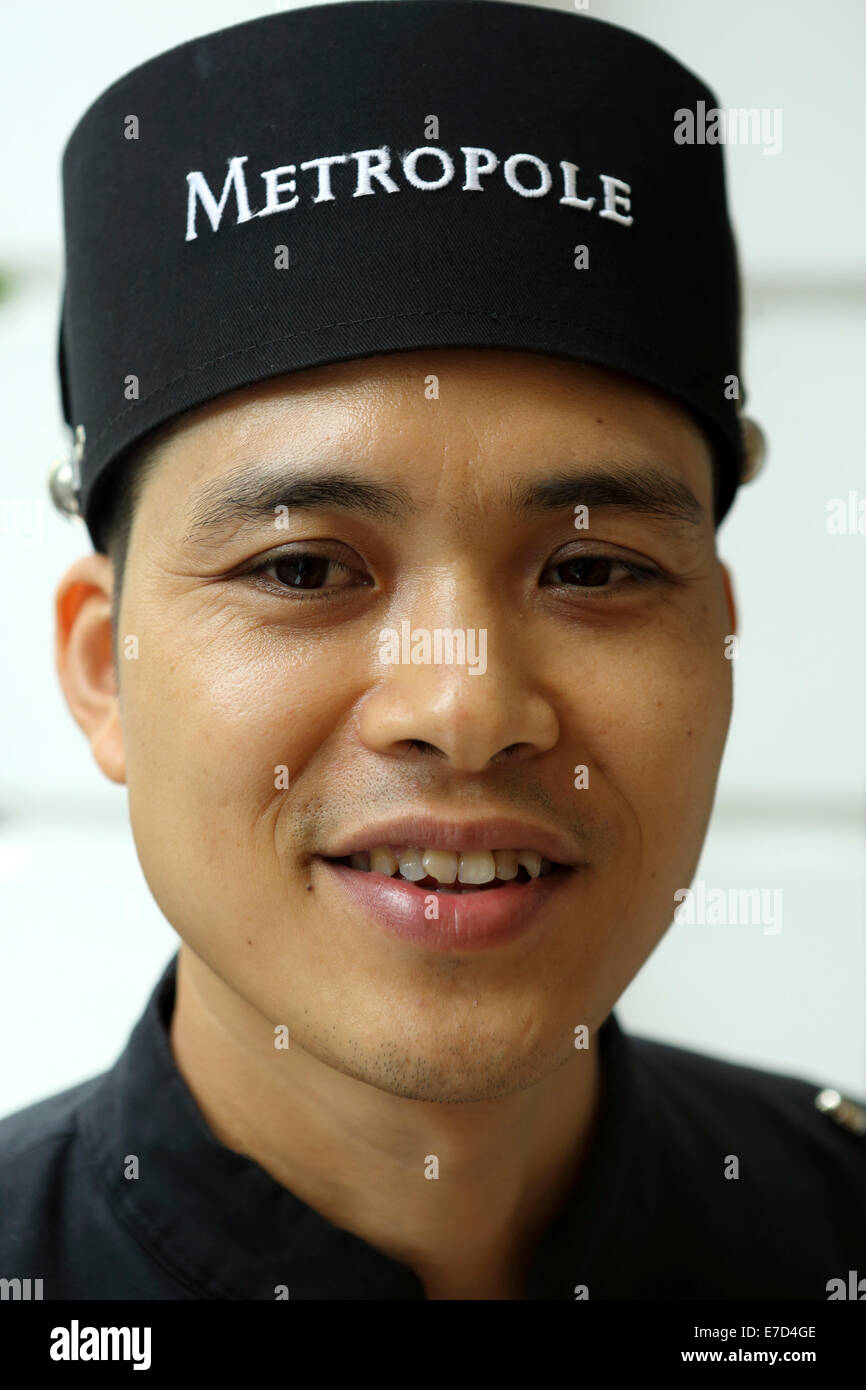 Bellboy at the Sofitel Metropole Hotel in Hanoi, Vietnam. - Stock Image