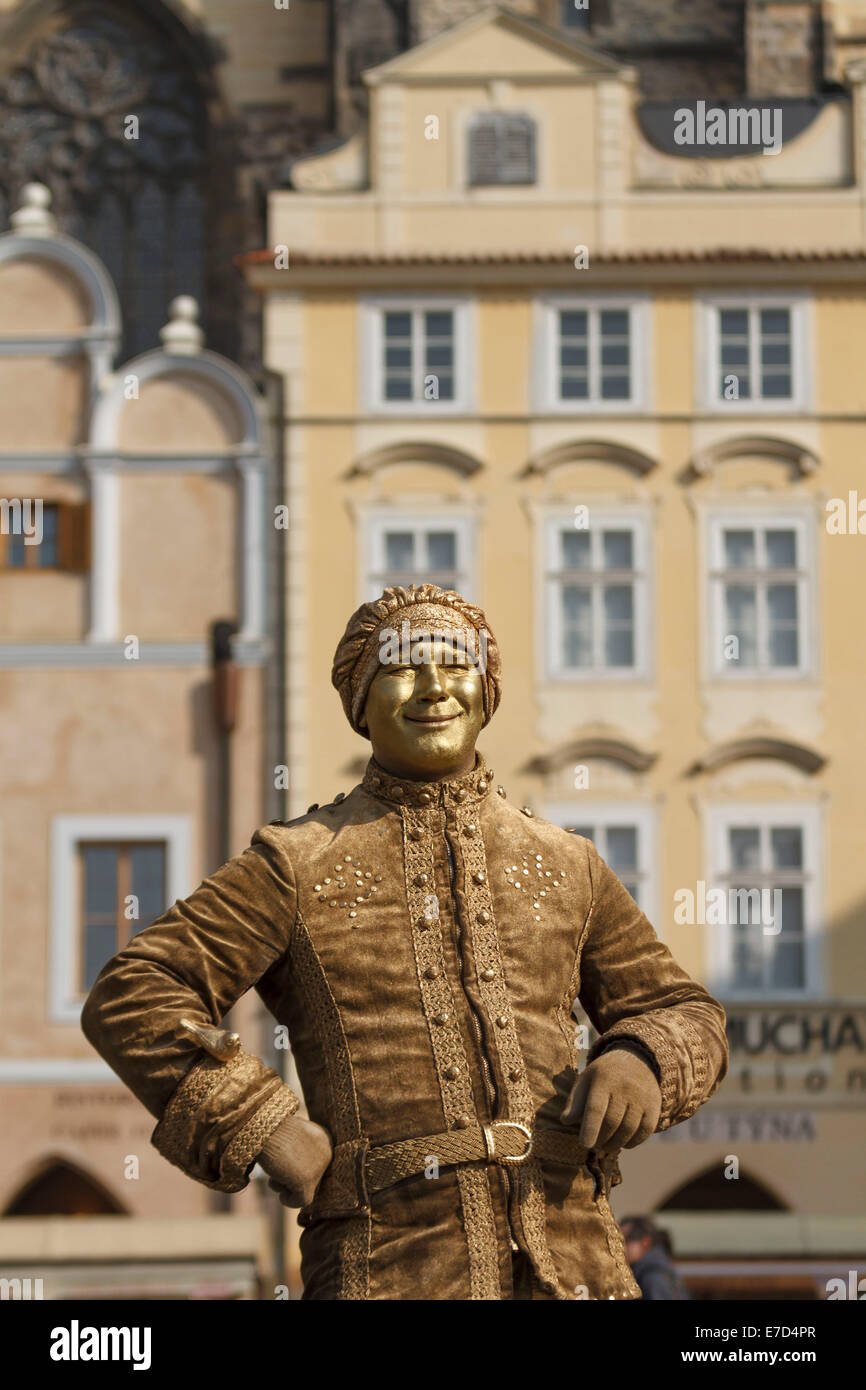 mime artist statue gold golden street performer performers busking busker buskers in an old square in Prague Czech - Stock Image