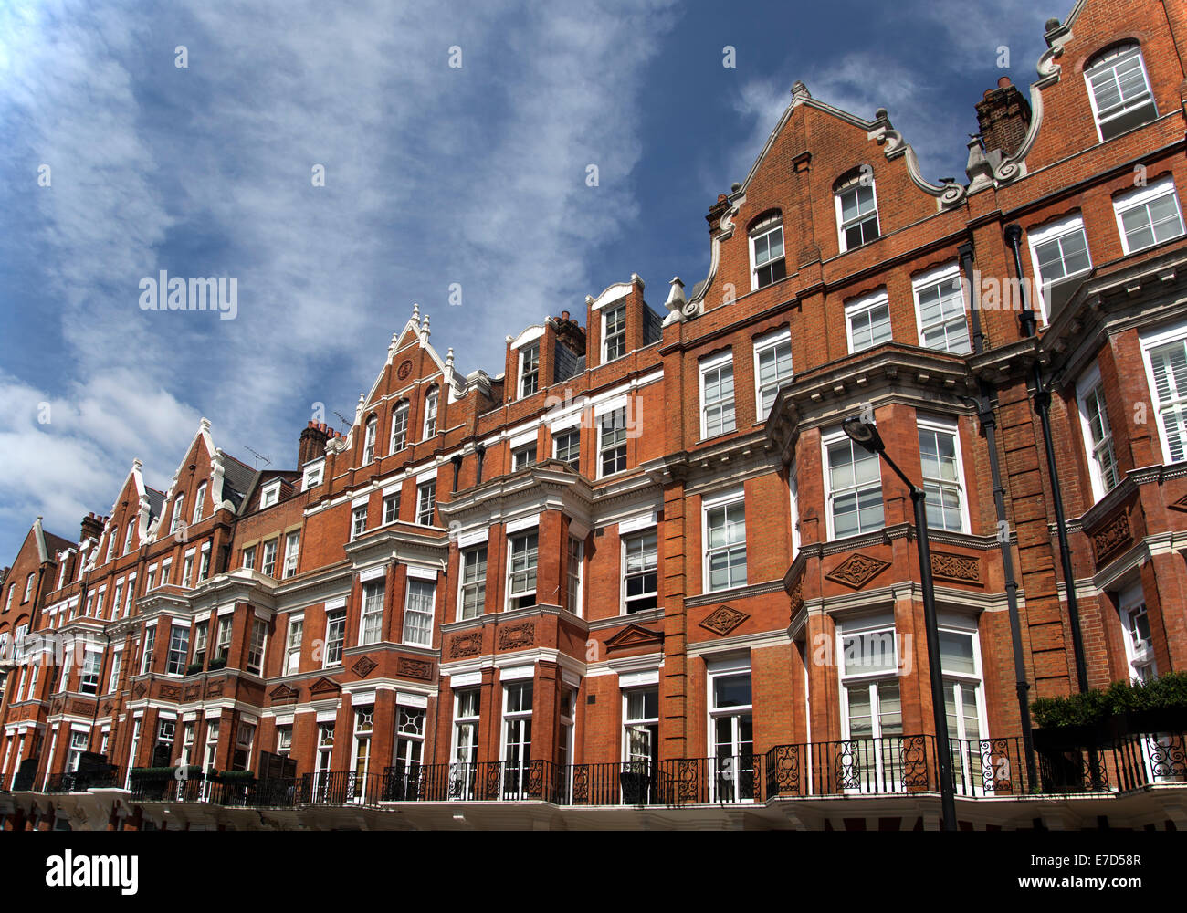Row of red brick apartments in Mayfair, London, UK - Stock Image