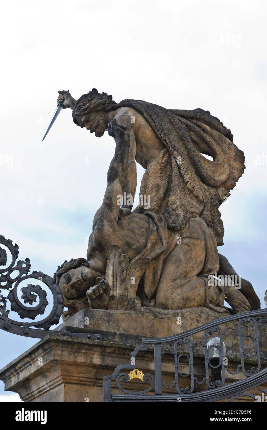 A giant statue with dagger at the main gate of Prague castle in the City of Prague, Czech Republic. - Stock Image