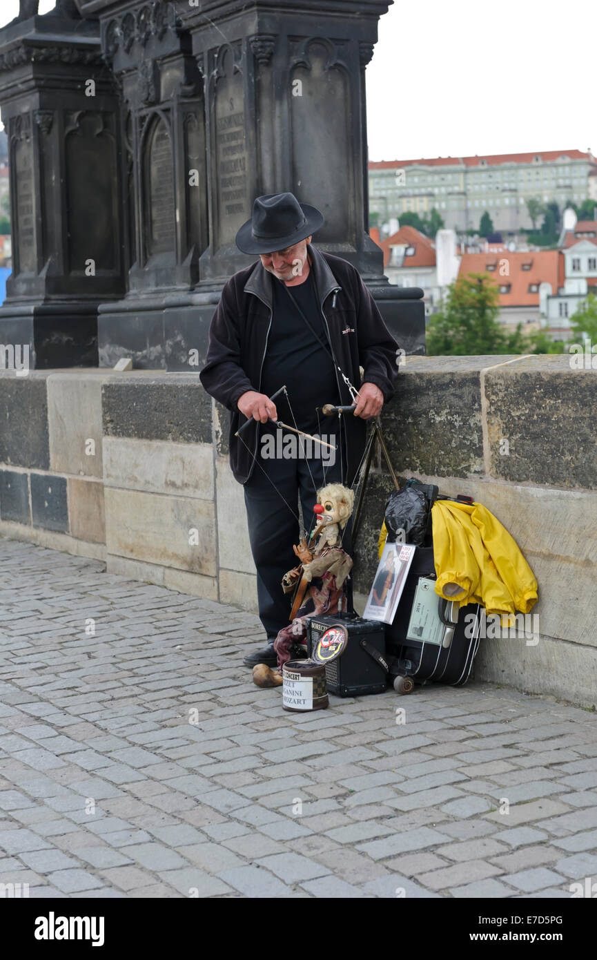 A puppeteer entertaining passer-by on Charles bridge in the City of Prague. Czech Republic. - Stock Image