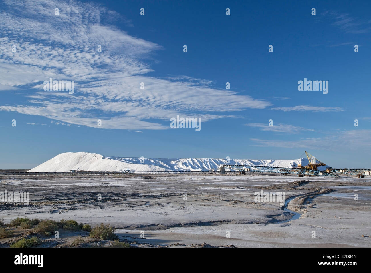 salt factory with mountain of white salt against a blue sky, Camargue, Rhone delta, France, Europe - Stock Image