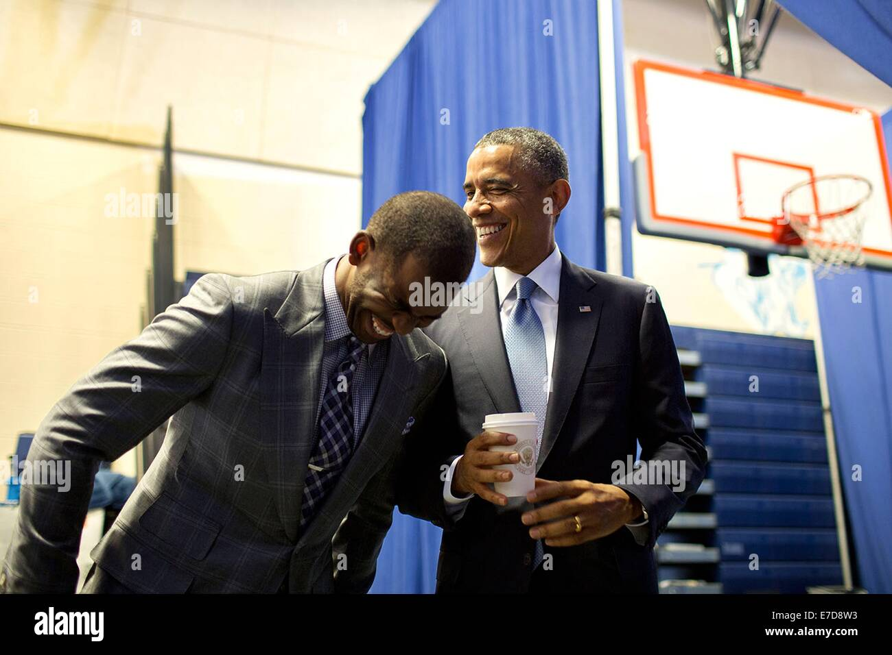 US President Barack Obama jokes with introducer Chris Paul prior to a 'My Brother's Keeper' initiative - Stock Image